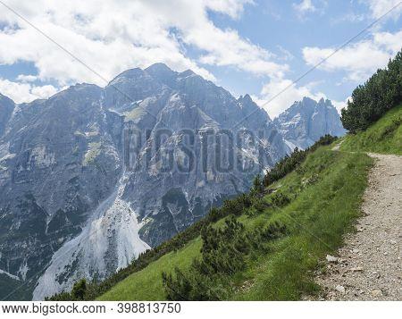 View On Limestone Moutain Peaks Footpath And Spruce Trees At Stubai Hohenweg, Alpine Landscape Of Ti