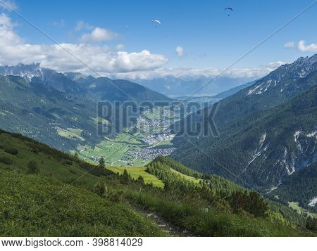 View Over Green Stubai Valley And Neustift Im Stubaital Village From Elferhutte With Moutain Peaks A