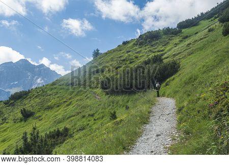 Green Summer Alpine Mountain Landscape With Tyrolean Walker At Stubai Hiking Trail, Stubai Hohenweg
