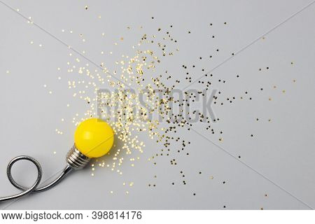 One Decorative Lamp On A Light Background With A Scattering Of Sparkles Of Stars Symbolizing The Ray
