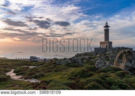 Malpica, Galicia / Spain - 26 November 2020: Sunset At The Punta Nariga Lighthouse In Galicia With A
