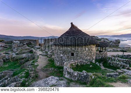 A View Of The Gaelic Ruins At Castro De Santa Tecla In Galicia At Sunrise