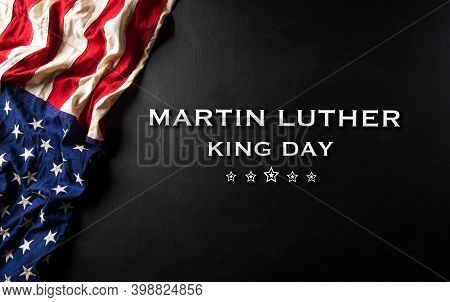 Martin Luther King Day Celebrated Concept. American Flag Against Wooden Background