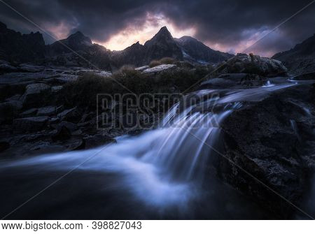 Rocky Creek Flowing Over The Rocks At Dramatic Twilight Near Teryho Chata Mountain Chalet In Hight T