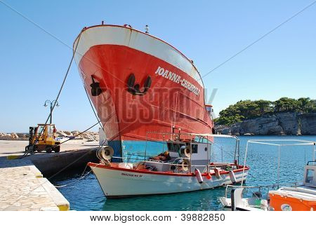 ALONISSOS, GREECE - SEPTEMBER 22: Freight ship Ioanna Chrisoula docked at Patitiri harbour on September 22, 2012 on Alonissos, Greece. Operated by Xak shipping, the ship supplies the Sporades islands.
