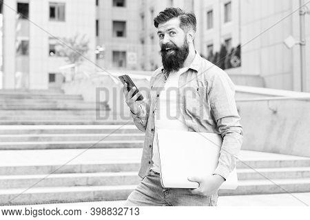 Work In Social Distancing Era. Man With Laptop Walking Empty Street. Business Center Reopening. Mode