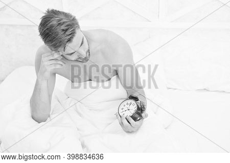 Morning Time. Sleepy Man Look At Alarm Clock In Bed. Sexy Guy Awake In Morning. Good Morning. Rise A