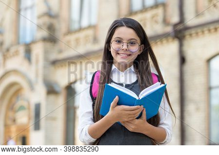 Be A Reader. Happy Kid Hold Library Book Outdoors. School Library. Reading And Literacy Education. B