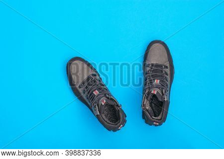 A Pair Of Mens Brutal Boots On A Bright Blue Background. Mens Shoes For Cold Weather. Casual Sports