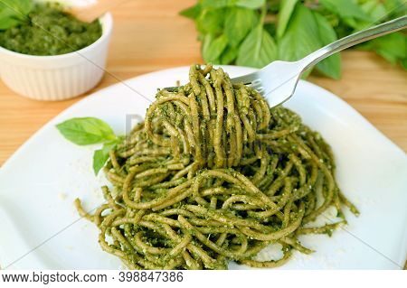 Fork Scooping Mouthwatering Whole Wheat Spaghetti With Pesto Sauce