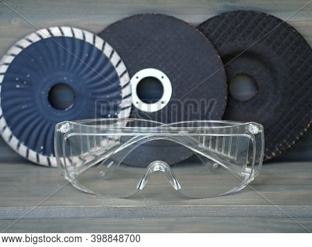 Cutting Discs For Angle Grinder. Protectiv Goggles. Cutting Discs On Gray Background. Construction T
