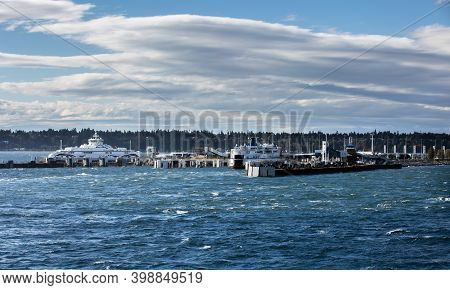 Passenger Ferry Terminal With Two Large Ferry Ships In Windy Weather And Stormy At A Background Of S