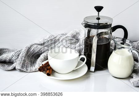French Press Coffee And Milk On The White Table With Sweater Background. Cinnamon Sticks And Anise S