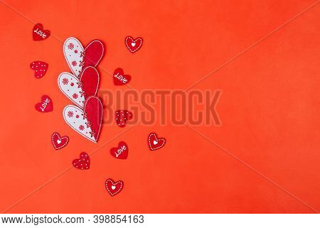 Red And White Hearts And Small Valentines On A Red Background With A Copy Space.top View, Flat Lay.