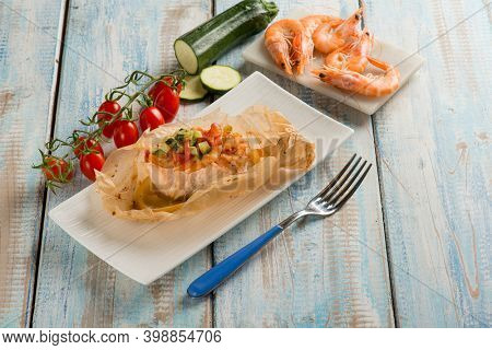 salmon and shrimp wrapped with tomatoes and courgettes