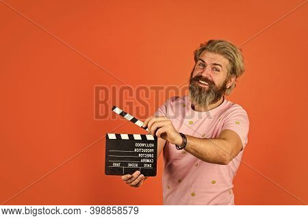 Professional Male Actor Ready For Shooting Film. Prepares For New Scene. Producer Holding Movie Clap