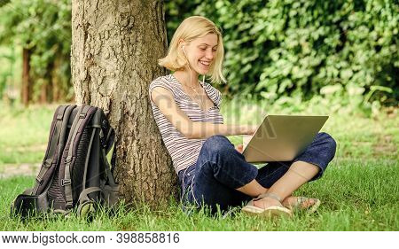 Girl Work With Laptop In Park. Reasons Why You Should Take Your Work Outside. Lunch Time Relax Or Co