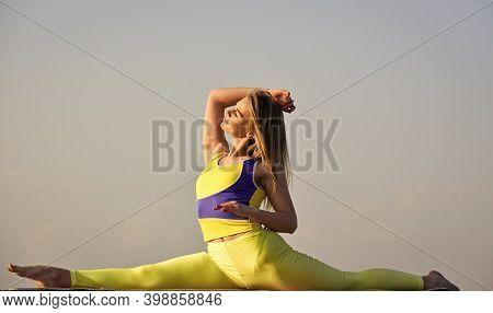 Woman Sit In Split. Flexible Girl In Sportswear. Young Attractive Woman Practicing Yoga. Splits Exer
