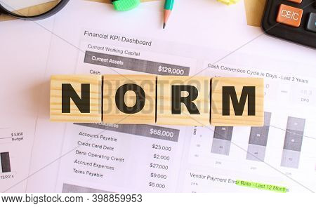 Wooden Cubes With Letters On The Table In The Office. Text Norm.