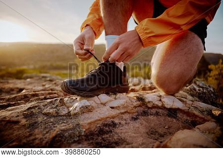 Closeup Of Hands Of Fit Male Jogger Tying Shoelaces Preparing For Cross Country Mountain Trail Run I