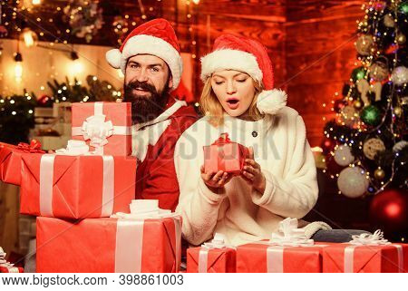 So Many Boxes For Us. Loving Couple Unpacking Gifts With Christmas Tree Background. Couple In Love E