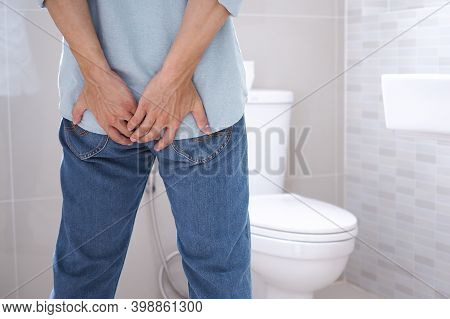 Asian Man Suffers From Diarrhea Near A Toilet Bowl Have Abdominal Stomachache ,constipation In Bathr