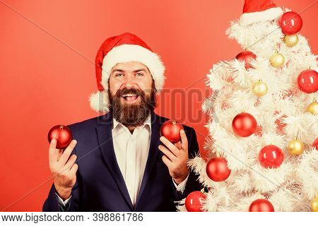 Get Into The Spirit Of The Season. Man With Beard Hold Red Balls Christmas Decorations. Winter Holid
