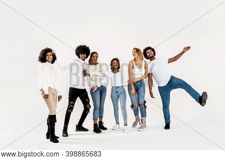 Photo Of Multiethnic Group Of Happy Young Friends Smiling And Posing Together Over White Studio Back