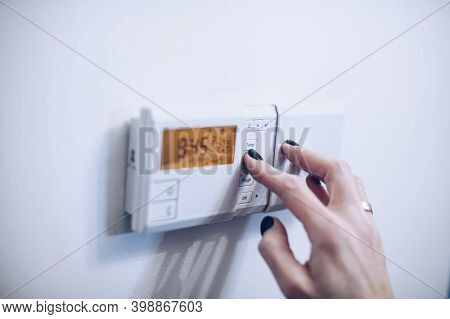 Regulating Temperature On Modern Home Heating Control Panel