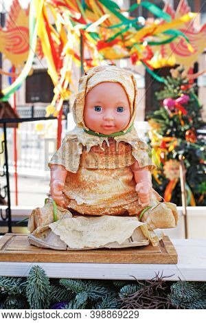 Moscow, Russia - February 25, 2020: Doll Dressed In Clothes Made Of Pancakes At Russian National Fes