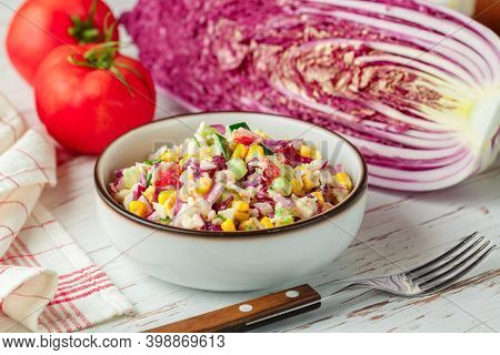 Delicious Red Peking Cabbage Salad With Tomatoes, Cucumbers, Corn, Onions And Crab Sticks In A White