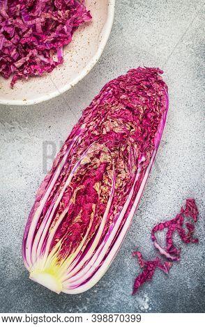 Red Peking Chinese Cabbage (purple Wombok). Half Napa Cabbage On Grey Background. Healthy Diet Veget