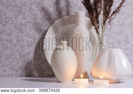 Relaxation Nordic Home Decor In Evening With Glowing Candles, White Simple Ceramic Crockery, Dried H