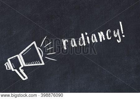 Chalk Drawing Of Loudspeaker And Handwritten Inscription Radiancy On Black Desk
