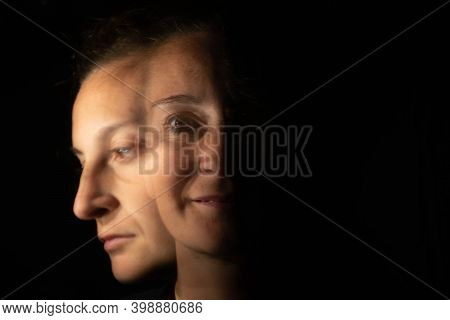 Dark Portrait Of A Smiling Woman With Only Half Her Face Lit Up On A Black Background That Unfolds I