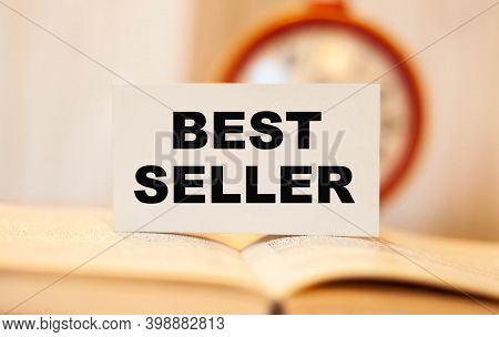 Bestseller Text On The Book On The Background Of The Clock.