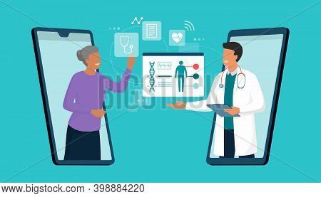 Online Doctor And Telemedicine: Senior Woman Connecting With A Doctor Online Using A Smartphone App