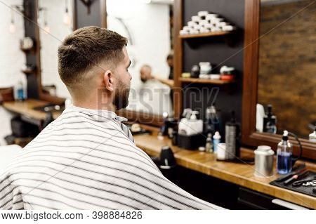 A Client In A Hairdressing Salon Changes His Hairstyle During A Haircut. Stylish Mens Haircut.beauti