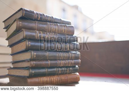 Brihuega, Spain 13-11-2020 Several Old And Slightly Worn Books Stacked In A Tower On A Desk In A Ant
