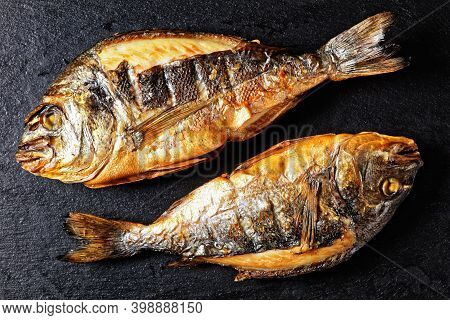 Grilled Whole Gilt-head Sea Bream, Orata,dorado Fish On A Slate Tray, Horizontal View From Above, Fl