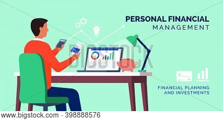 Personal Finance Management: Man Managing His Personal Finances At Home Using A Calculator And A Fin