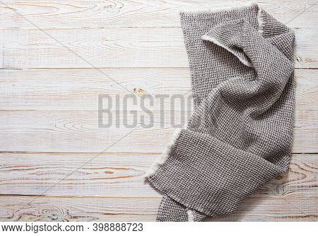 Gray Linen Napkin On White Wooden Table Top View - Close Up