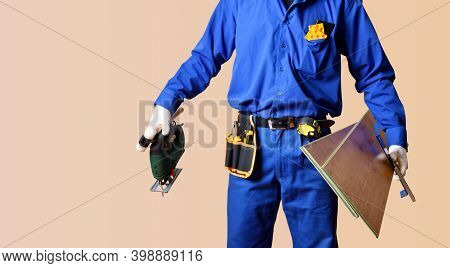 Background Detail Of The Body Of A Parquet Installer Dressed In Overalls And Provided With Tools And