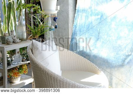 White Wicker Rattan Chair Sofa On Patio At Home