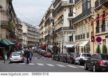Paris, France - July 21, 2011: People Visit Rue Marbeuf Fashion Street In Paris, France. Paris Is Th
