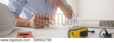 Architect Working In Office With Blueprints,engineer Thinking And Planning Inspection In Workplace F