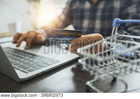 Shopping Online, Shop And Pay By Credit Card, Business Man   Enter Code And Serial Number On Laptop