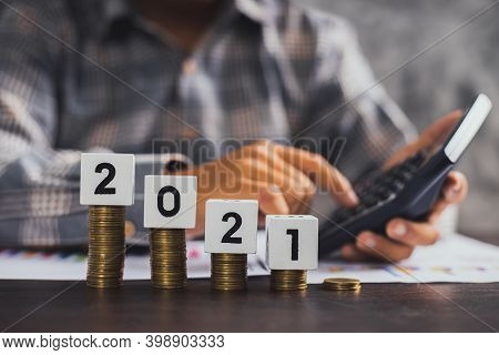 Save And Financial Management Concept, Close Up Hand Of Business Man Calculate Economy Cash And  Sta