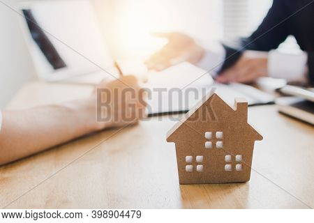 Real Estate Concept, Buying Renting Apartment Or House, And Signing Documents For Realty Purchase