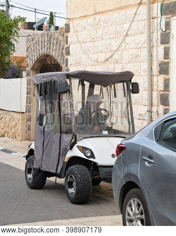 Nazareth, Israel, December 05, 2020 : Muslim Circassian Woman Sits In An Electric Car In The Muslim